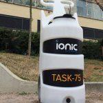 Man wheeling Task portable window cleaning equipment
