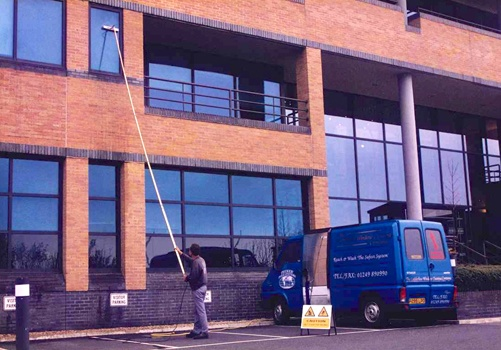 Window cleaner using a waterfed pole to clean windows