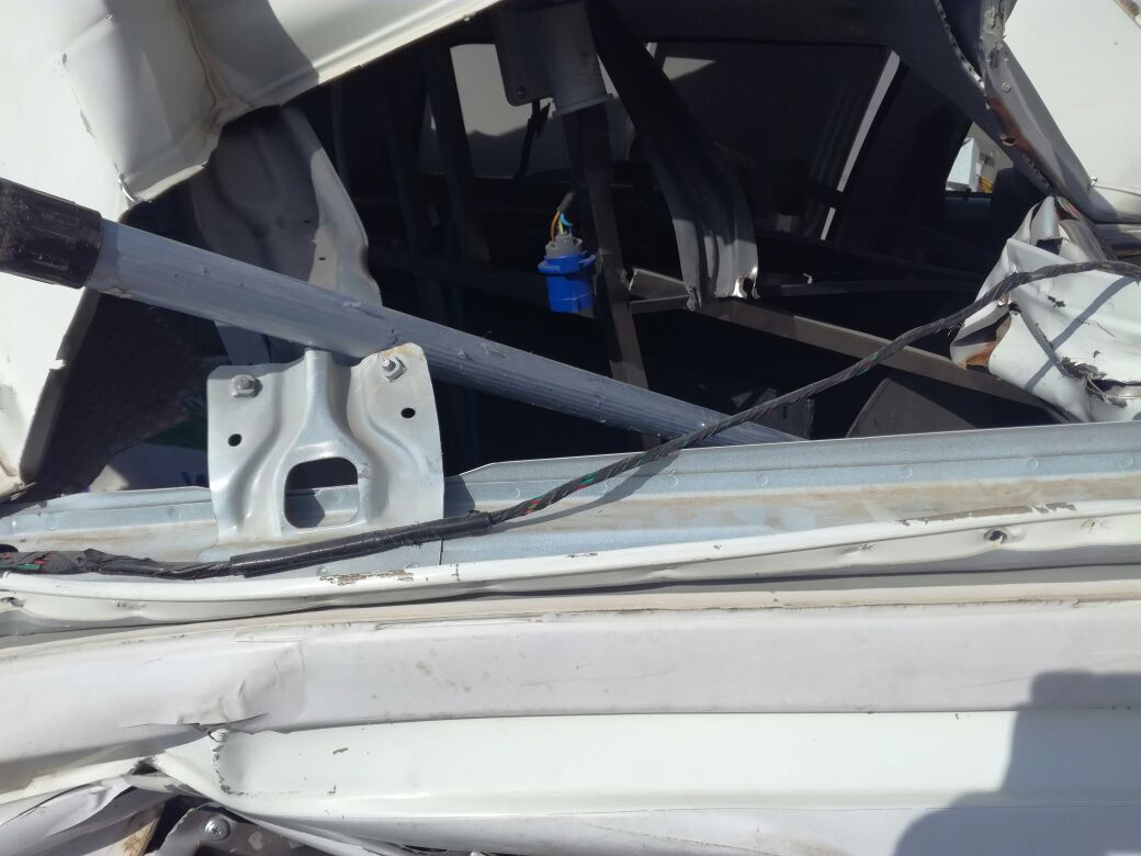 Photographs from a Saudi Arabia showing the extensive damage sustained to a Window Cleaning van